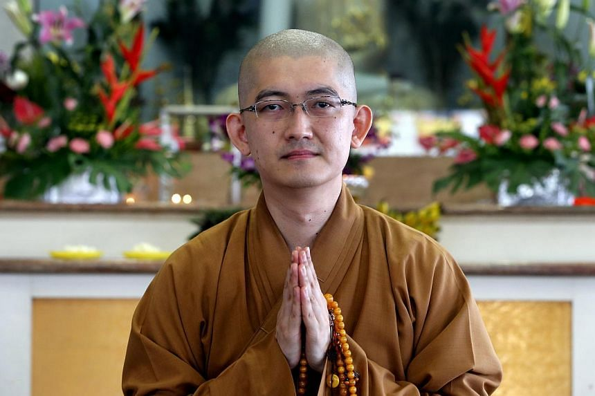 Venerable Shi You Guang is now a spiritual adviser at Puat Jit Buddhist Temple in Sengkang, where he conducts Buddhist classes and gives talks. -- ST PHOTO: CHEW SENG KIM