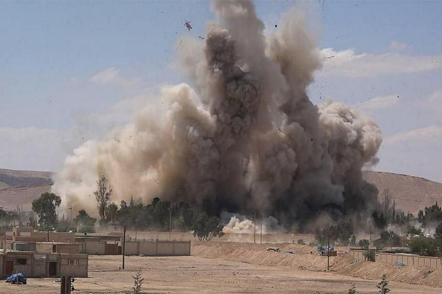 An image made available by Jihadist media outlet Welayat Homs on May 30, 2015, allegedly shows the prison of the Syrian city of Palmyra being blown up by Islamic State group jihadists, 10 days after they seized the ancient city from pro-regime forces