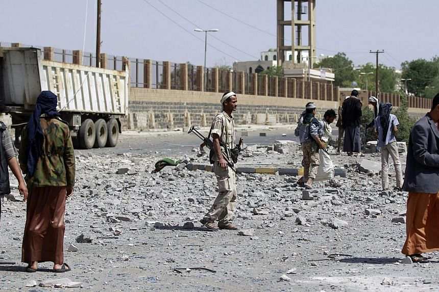 Huthi Shi'ite militants inspect damage following an air-strike by the Saudi-led coalition in Al-Thawra sport city, located north of the capital Sanaa on May 31, 2015. Several Americans have been detained in Yemen, a State Department official said Sun