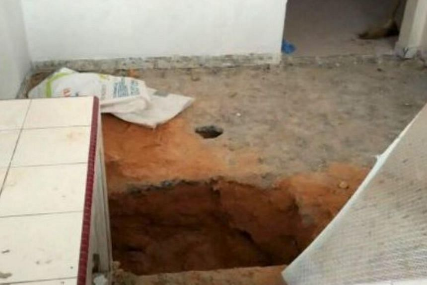 The body of a child was found buried in cement in the kitchen floor of a house in Taman Usaha Jaya, Kepong, on Friday, May 29, 2015. -- PHOTO: THE STAR/ASIA NEWS NETWORK