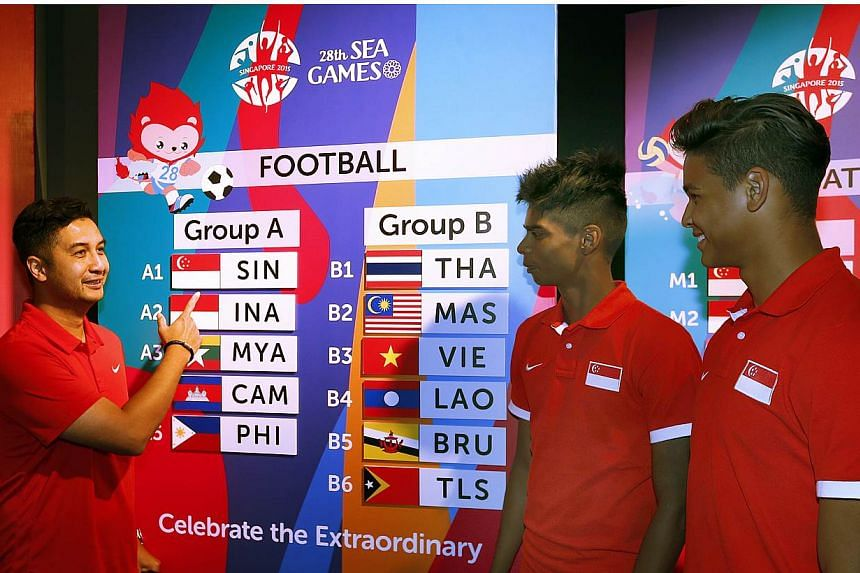 (From left) National Under-23 coach Aide Iskandar with players Iqbal Hussain and Irfan Fandi examining the draw conducted on April 15, 2015 for the June SEA Games. Aide has issued a warning to his charges, reminding them not to underestimate the