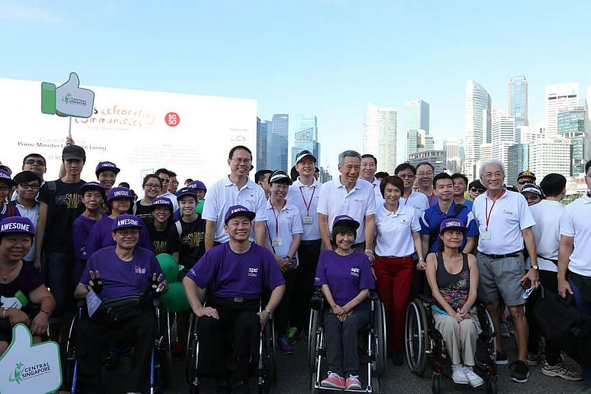 People participating in theNeighbours For Active Living programme also took part in theCDCs' Celebrating Communities' event, a 2.5km community parade and brisk walk around the Marina Bay area.-- ST PHOTO:ONG WEE JIN