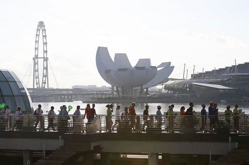 About 5,000 people participated in the CDCs' Celebrating Communities' event, a 2.5km community parade and brisk walk around the Marina Bay area.-- ST PHOTO:ONG WEE JIN
