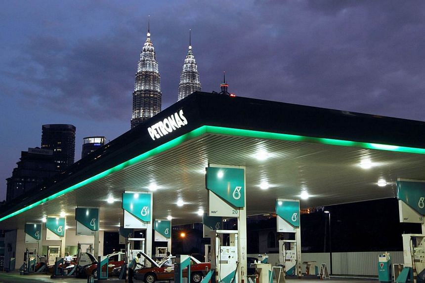 Malaysia's fuel prices will go up at midnight by 10 Malaysian cents across the board.-- PHOTO: BLOOMBERG