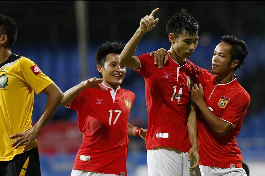 Laos' Soukchinda Natphasouk (second from right) celebrates with his teammates after scoring his team's second goal against Brunei in the 28th SEA Games men's football first round group B match at the Bishan Stadium on 31 May 2015. --ST PHOTO: K