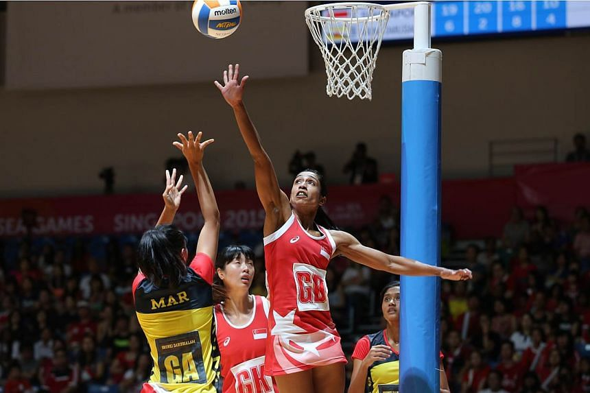 Singapore's goal defence Premila Hirubalan blocking a shot during the SEA Games netball match against Brunei on Sunday, May 31, 2015. -- ST PHOTO: ONG WEE JIN