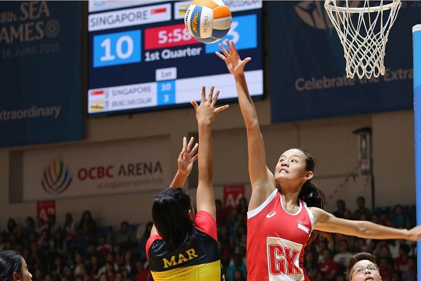 Singapore captain Micky Lin intercepting a shot during the SEA Games netball match against Brunei on Sunday, May 31, 2015. -- ST PHOTO: ONG WEE JIN