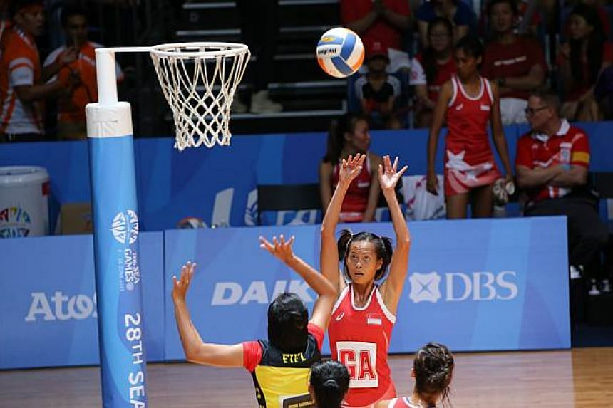 Singapore goal attack Chen Huifen taking a shot against Brunei during the SEA Games netball match on Sunday, May 31, 2015. -- ST PHOTO: ONG WEE JIN
