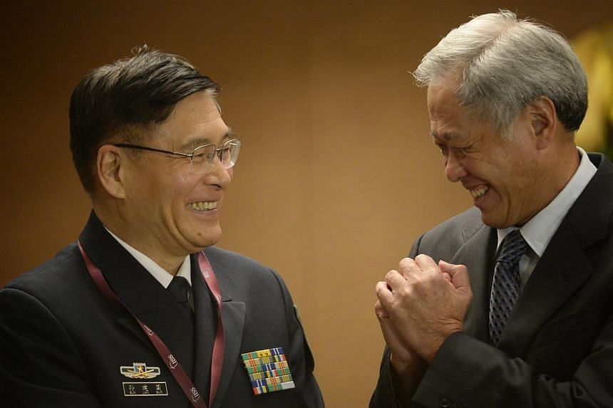 Chinese Deputy Chief, General Staff Department, People's Liberation Army, Admiral Sun Jianguo (left) is greeted by Singaporean Defence Minister Ng Eng Hen during the Ministerial Luncheon during the IISS Shangri-La Dialogue on May 31, 2015. -- ST PHOT