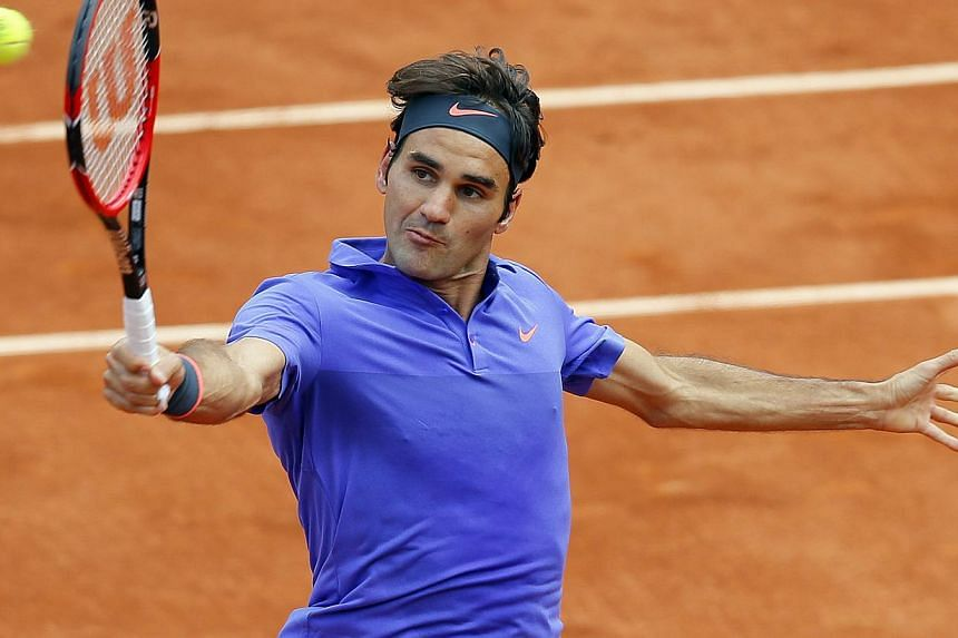 Roger Federer of Switzerland in action against Gael Monfils of France during their fourth round match for the French Open tennis tournament at Roland Garros in Paris, France on June 1, 2015. -- PHOTO: EPA