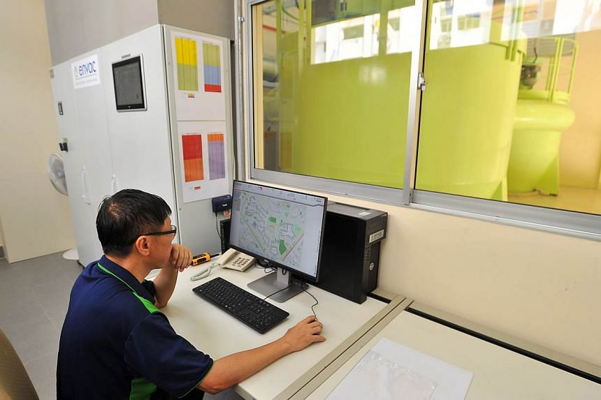 A staff member monitoring the pneumatic waste conveyance system in the control room of the centralised bin centre on May 28, 2015. -- ST PHOTO: LIM YAOHUI FOR THE STRAITS TIMES