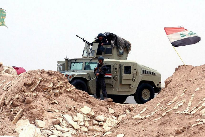 An Iraqi soldier stands guard at a military barracks near Ramadi city, western Iraq, on June 1, 2015.A suicide attack using an armoured vehicle packed with explosives against an Iraqi police base north-west of Baghdad killed at least 37 people