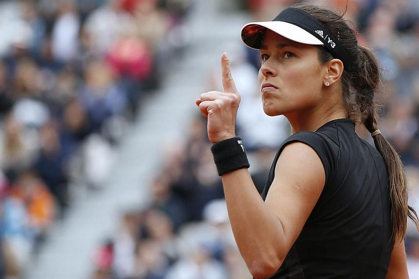 Ana Ivanovic celebrates after winning a point against Russia's Ekaterina Makarova during the women's fourth round of the Roland Garros 2015 French Tennis Open in Paris on Sunday (May 31). PHOTO: AFP