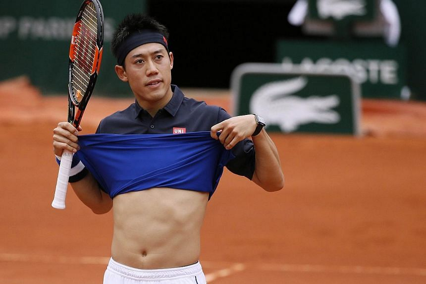 Japan's Kei Nishikori gestures during his match against Russia's Teymuraz Gabashvili during the men's fourth round of the Roland Garros 2015 French Tennis Open in Paris on Sunday (May 31). -- PHOTO: AFP