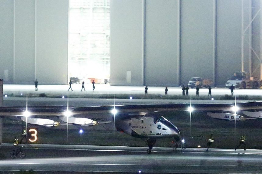 The Solar Impulse 2 touches down at Nagoya airport in Japan on MOnday night (June 1). -- PHOTO: REUTERS
