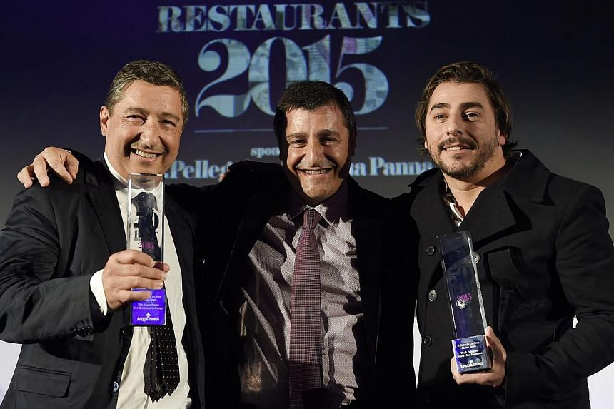 Spanish pastry chef Jordi Roca (right), chef Joan Roca (left) and sommelier Joseph Roca (centre), brothers and owners of the restaurant El Celler de Can Roca in Girona, Spain, smile after winning the best restaurant prize during the ceremony for the
