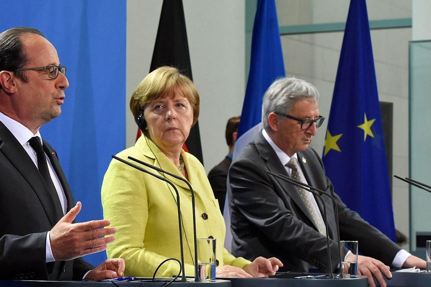 (Left to right) French President Francois Hollande, German Chancellor Angela Merkel and European Commission President Jean-Claude Juncker addressing a press conference prior to talks with representatives of the of the European Round Table of Industri
