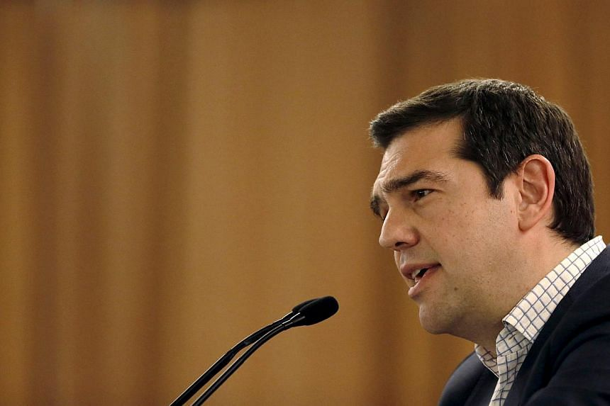 "Greece's PM Alexis Tsipras attacked the country's creditors for insisting on what he described as ""absurd"" reforms which have only held up progress in negotiations for a deal aimed at preventing his country from defaulting. -- PHOTO: AFP"