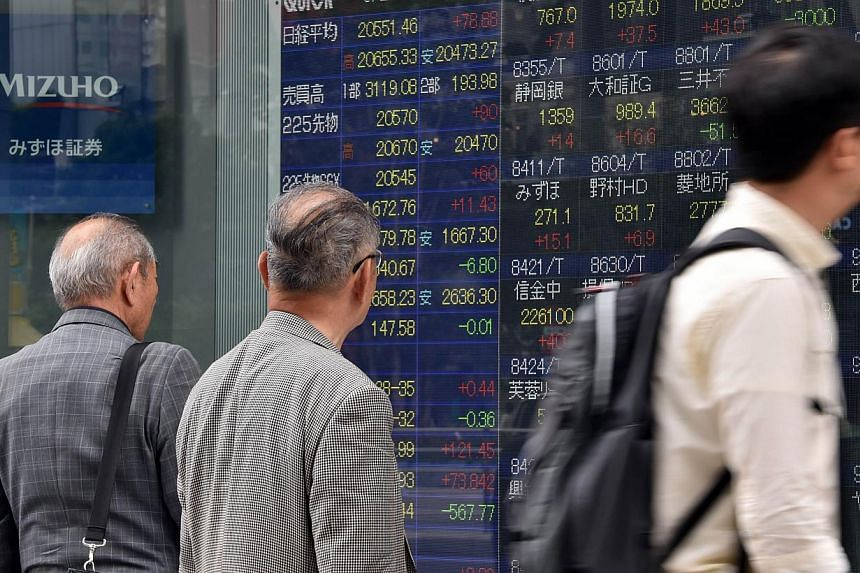 Most Asian stocks advanced as the yen held near a 12-year low against the US dollar after data showed growth in US manufacturing. -- PHOTO: AFP