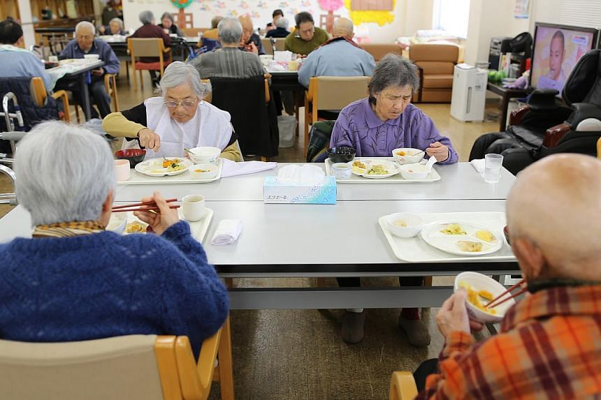Elderly people at a daycare facility on Gogo Island in Matsuyama, Ehime Prefecture, in 2013. Japan's government sought on Tuesday to assure the public that their pensions were not at risk after a big data leak. -- PHOTO: BLOOMBERG
