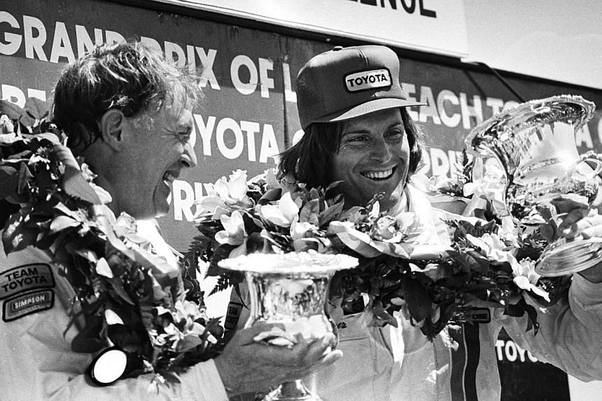 Racer Dan Gurney shares the Winner's Circle with Bruce Jenner (right) at the 1982 Toyota Pro/Celebrity Race at the Long Beach Grand Prix, in Long Beach, California in this April 3, 1982 photograph. -- PHOTO: REUTERS
