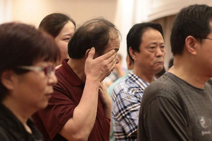 "Relatives of passengers on board the Dongfangzhixing or ""Eastern Star"" which sank en route from Nanjing to Chongqing, react as they wait for information at a hotel in Nanjing, Jiangsu province on June 2, 2015. Family members of some of the passengers"