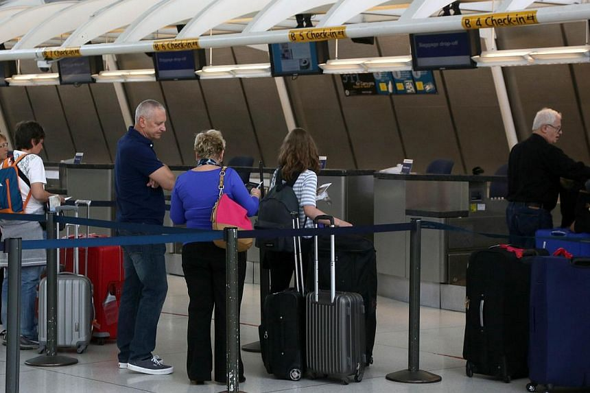 Passengers at New York's John F Kennedy Airport on May 25, 2015. US airport screeners did not detect banned weapons in 67 of 70 tests at dozens of airports, media reports said. -- PHOTO: AFP