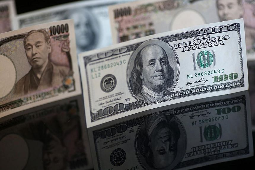 The U.S. dollar hit a more than 12-year high against the yen on Tuesday as upbeat US data reignited talk of an interest rate hike this year. -- PHOTO: BLOOMBERG