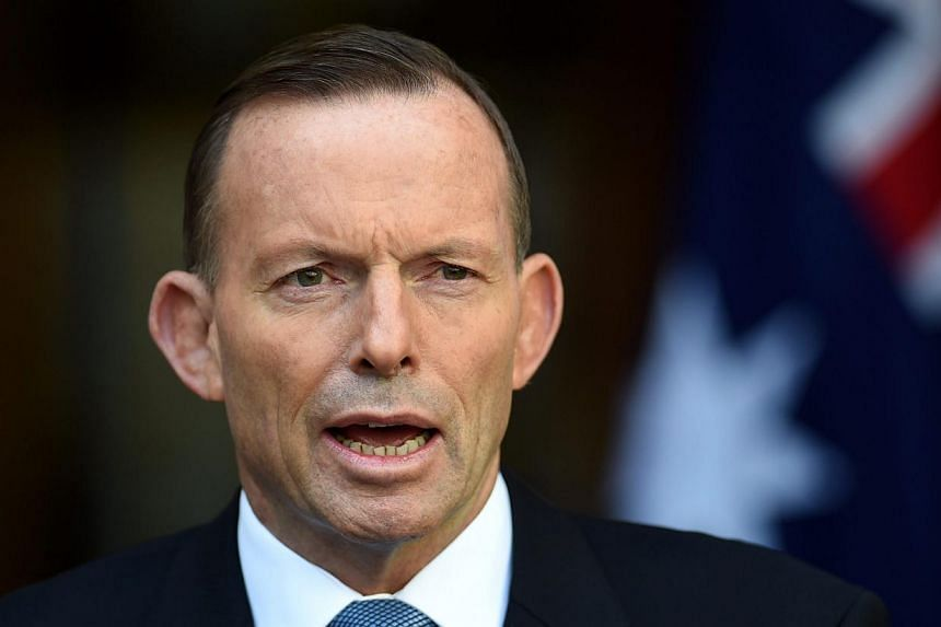 Australian Prime Minister Tony Abbott has reprimanded his ministers after proposals made during Cabinet discussions were leaked to the media before he announced it. -- PHOTO: EPA