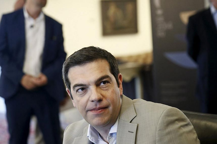 Greek Prime Minister Alexis Tsipras looks on during a meeting at the Ministry of Culture, Education and Religious Affairs in Athens June 2, 2015. -- PHOTO: REUTERS