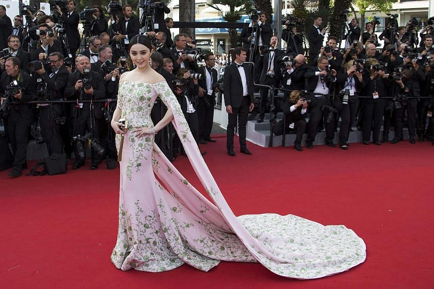 On the same day, Fan was wearing a pink embroidered Ralph & Russo gown. -- PHOTO: REUTERS