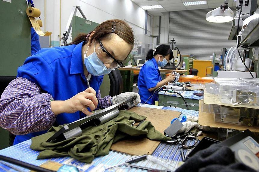 Singapore's manufacturing sector showed some signs of recovery as activity expanded for the first time this year, raising hopes for brighter outlook ahead. -- PHOTO: BUSINESS TIMES