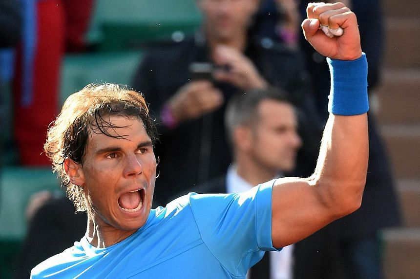 Spain's Rafael Nadal celebrates his victory over Jack Sock of the US at the end of their men's fourth round of the Roland Garros 2015 French Tennis Open in Paris on June 1, 2015.Nadal believes all the pressure will be on Novak Djokovic in Wedne