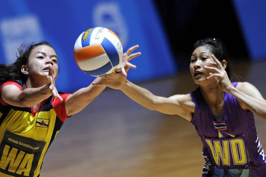 Brunei's Dk Khalisha Pg Abd Rahman (left) with Thailand's Paweena Kamwan in action at the 28th SEA Games. Brunei threatened to cause an upset against Thailand in the SEA Games netball competition on Tuesday, but ran out of steam in the end as Thailan