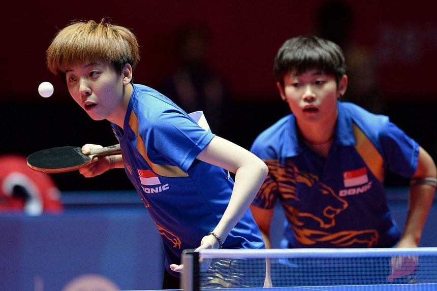 Singapore got its first gold medal at the 28th SEA Games from Lin Ye and Zhou Yihan, who won the table tennis women's doubles on Tuesday night. -- PHOTO: REUTERS