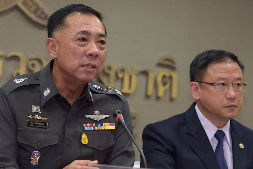 Thai police General Aek Angsananont (left) answers a question from journalists next to Anti-Money Laundering Office secretary-general Seehanat Prayoonrat (right) at police headquarters in Bangkok on June 2, 2015. AThai court has issued an arres