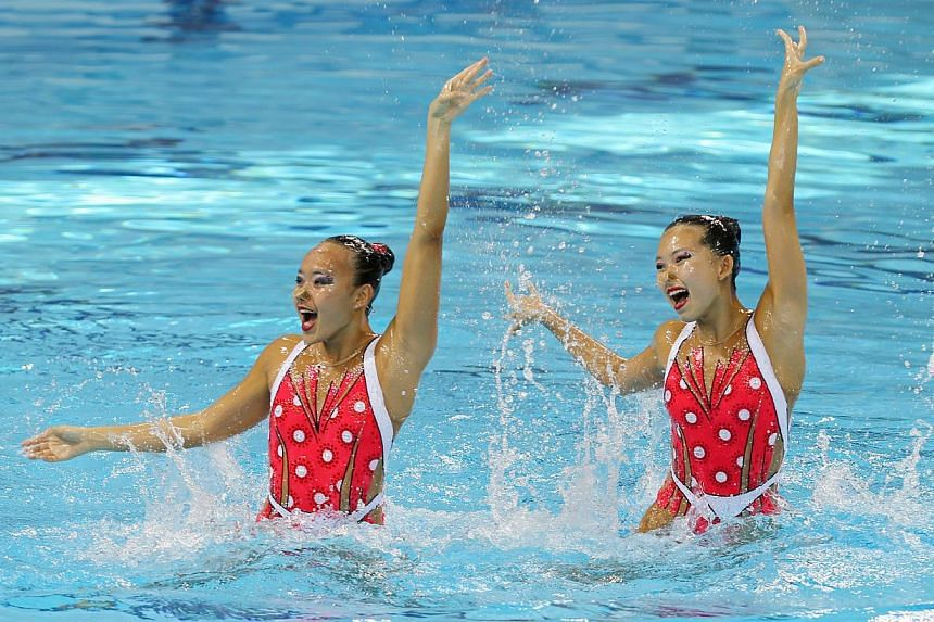 Singapore's Chen Mei Qi, Stephanie (left) and Yap Yu Hui, Crystal compete in the 28th SEA Games synchronised swimming Duet Technical event on Tuesday, June2, 2015, at the OCBC Aquatics Centre. -- ST PHOTO: SEAH KWANG PENG