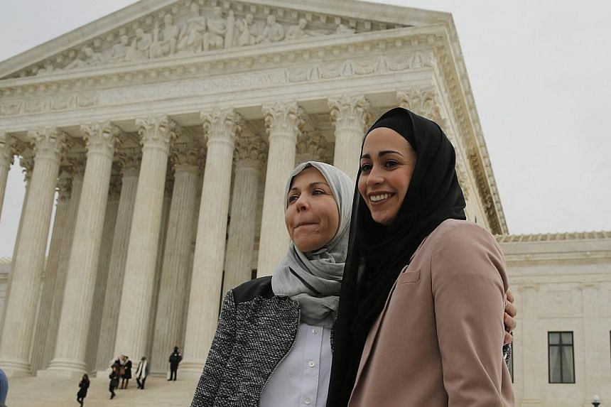 Muslim woman Samantha Elauf (right), who was denied a sales job at an Abercrombie Kids store in Tulsa in 2008, stands with her mother Majda outside the US Supreme Court in Washington, in this February 25 file photo. -- PHOTO: REUTERS