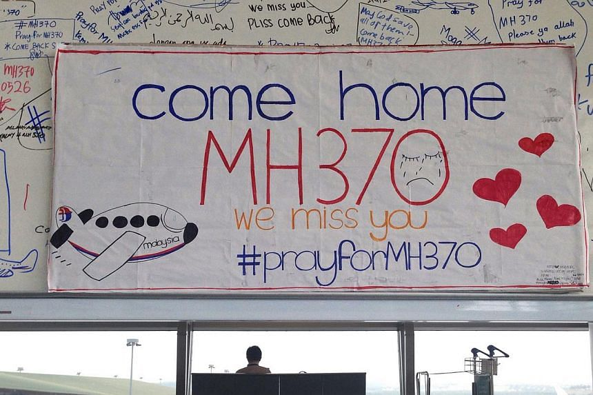 A white board with written prayers at the viewing gallery of Kuala Lumpur International Airport for Malaysia Airlines Flight MH370 after it went missing on March 8,2014. The hunt for missing Malaysia Airlines Flight MH370 will not be expanded b