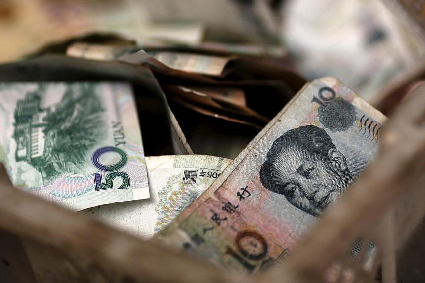 On average, Asians hold 37 per cent of their assets in their local currency, while Singaporeans hold about 33 per cent in Singapore dollars. -- PHOTO: REUTERS