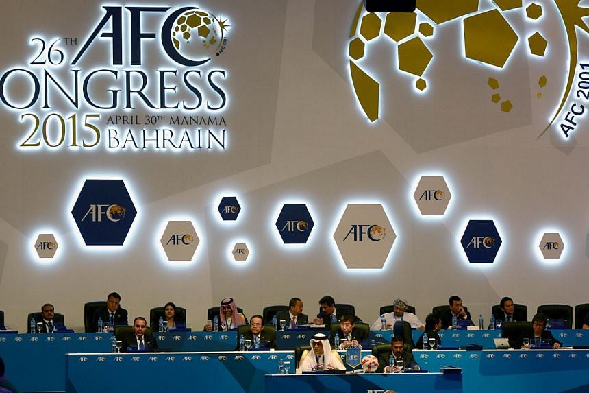 """Delegates and officials take part in the Asian Football Confederation (AFC) regional Congress on April 30, 2015 in the Bahraini capital Manama. The AFC pledged on Wednesday to help """"find the best way forward"""" for world football following the surprise"""