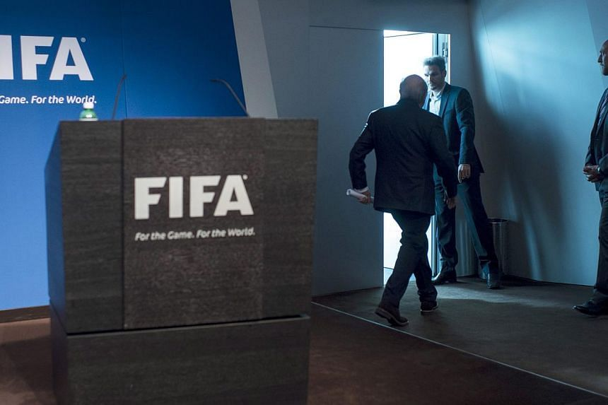 Fifa president Joseph S. Blatter (centre) leaves after speaking at a press conference at the Fifa headquarters in Zurich, Switzerland, on June 2, 2015. -- PHOTO: EPA