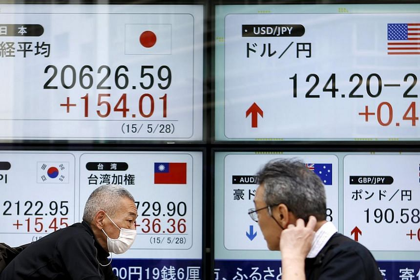 Most Asian stocks fell as Japanese shares slid on a stronger yen and investors awaited the outcome of talks between Greece and its creditors. -- PHOTO: REUTERS