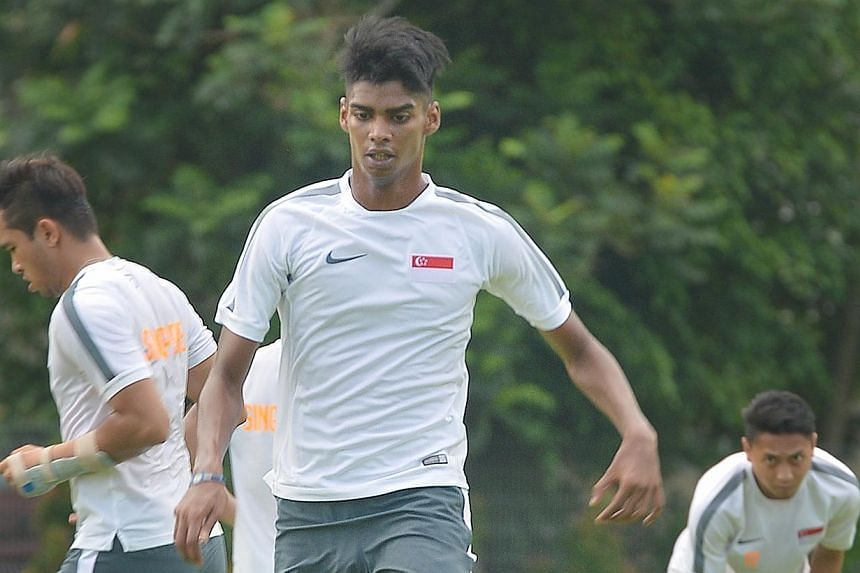 Lions coach Bernd Stange has called up striker Iqbal Hussain (centre) for the World Cup qualifier against Japan, in a move that came just days after he was dropped by Aide Iskander from the SEA Games squad. -- ST PHOTO: ALPHONSUS CHERN