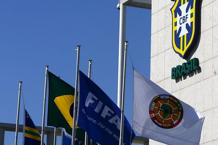 A Fifa flag flying outside the Brazilian Football Confederation headquarters in Rio de Janeiro last week. The confederation removed the name of Jose Maria Marin from the facade of its headquarters one day after its former president was arrested in a
