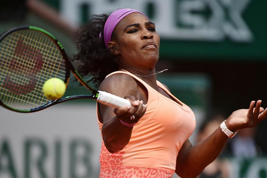Serena Williams returns to Italy's Sara Errani during their women's quarter final match of the Roland Garros 2015 French Tennis Open in Paris on June 3, 2015. -- PHOTO: AFP
