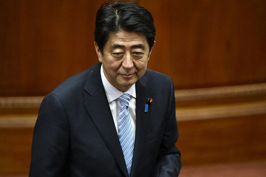 """Japanese Prime Minister Shinzo Abe's ruling party called for a """"cautious response"""" to the China-led Asian Infrastructure Investment Bank (AIIB), but will leave the decision on joining to the premier, a draft report shows on Wednesday. -- PHOTO: EPA"""