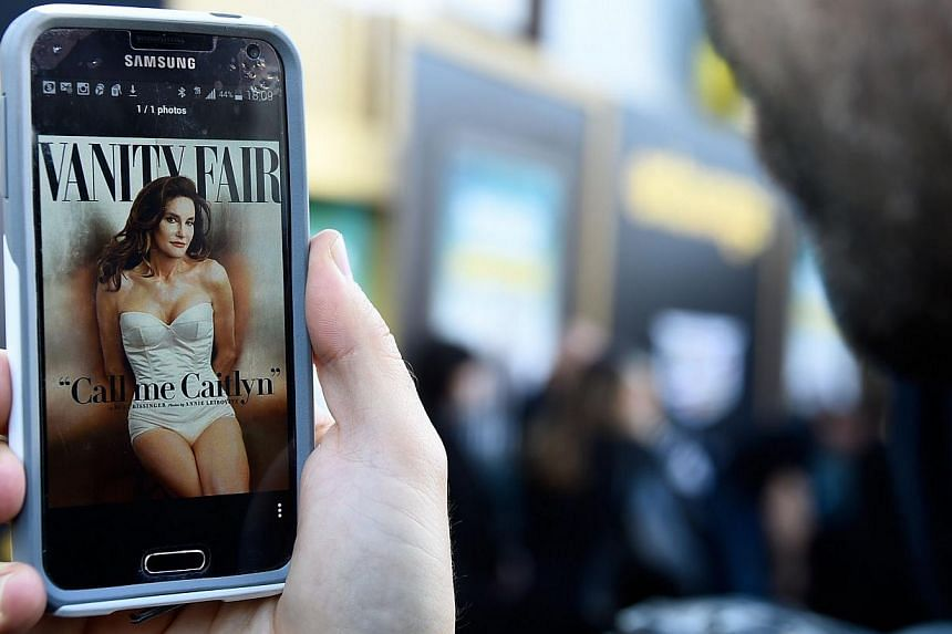 A man viewing the July cover of Vanity Fair featuring Caitlyn Jenner on June 1, 2015. -- PHOTO: AFP