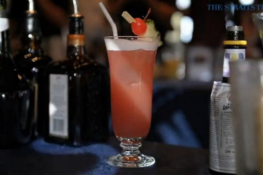 The Singapore Sling, a cocktail that was created at the Raffles Hotel in 1915, celebrates its centennial anniversary this year. -- PHOTO: SCREENGRAB FROM RAZORTV VIDEO