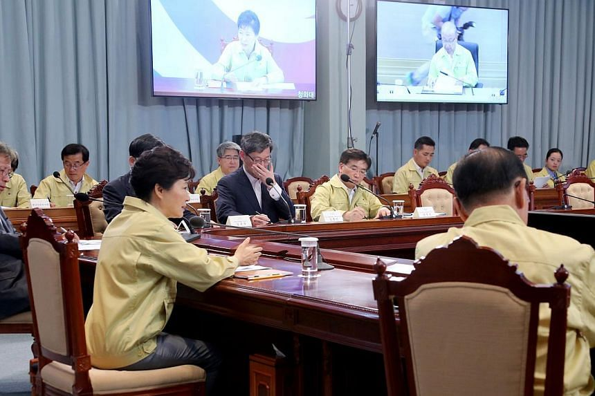 South Korean President Park Geun-hye (second left, front) presides over an emergency meeting at the presidential office Cheong Wa Dae in Seoul, South Korea on June 3, 2015. The meeting focused on measures to contain the Middle East Respiratory Syndro